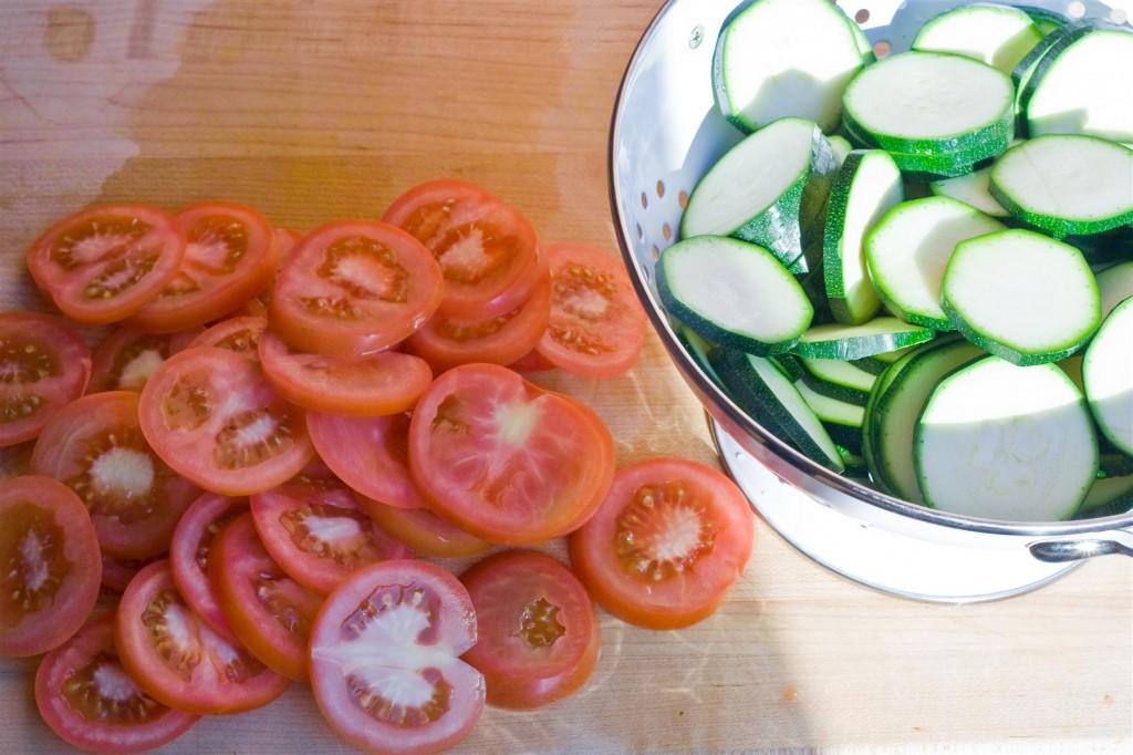 Slicing the courgette and tomato